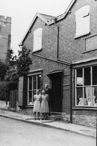 Mr Hudson and his daughters outside their drapers shop in Church Street, Leintwardine 1940's
